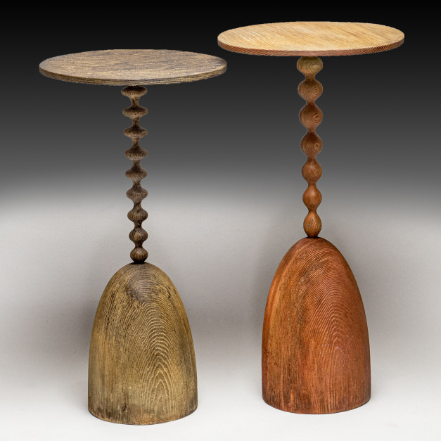 A one off pair of cocktail tables handmade in solid cast